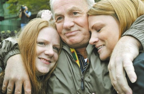 Ivan Henry with his daughters upon his acquittal and release from prison in 2010